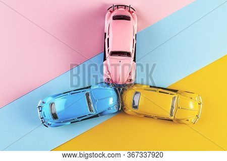 Izhevsk, Russia, February 15, 2020. Toy Cars In Accident On A Pastel Colorful Background. Three Car