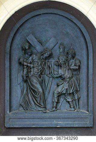 ZAGREB, CROATIA - NOVEMBER 12, 2012: 5th Stations of the Cross, Simon of Cyrene carries the cross, St Francis Xavier's Church in Zagreb, Croatia