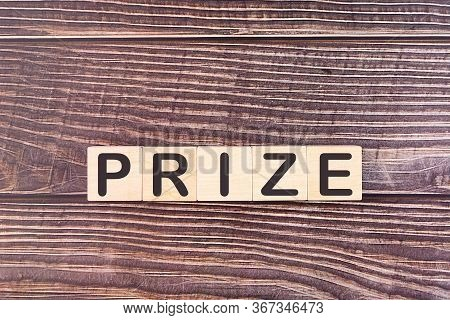 Prize Word Made With Wood Building Blocks.