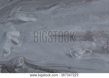 Mud From Volcano Texture. The Berca Mud Volcanoes Is A Geological And Botanical Reservation. Small V