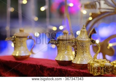 Arab, Turkish Set For A Tea Drinking. Teapots And Glass Multi-colored Glasses On A Gilded Tray. Trad