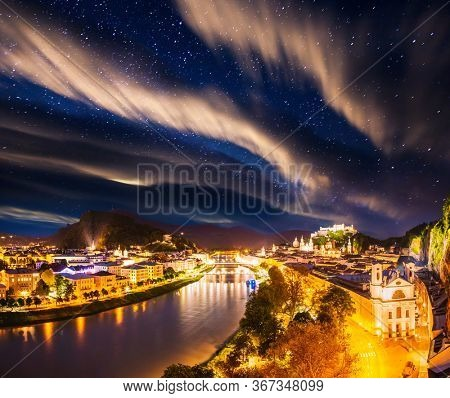 Scenic top view of the Salzburg city at night. Location place Festung Hohensalzburg, Salzburger Land, Austria, Europe. Photo of popular tourist attraction of the world. Discover the beauty of earth.
