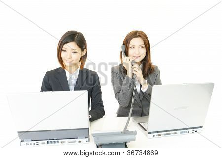 Portrait of two business women in their office