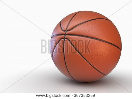A Regulation Orange And Black Rubber Basketball In Dramatic Lighting On An Isolated White Studio Bac