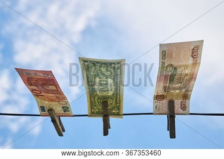 Rubles, Dollars And Euros Hang On A Clothesline, Bottom View.