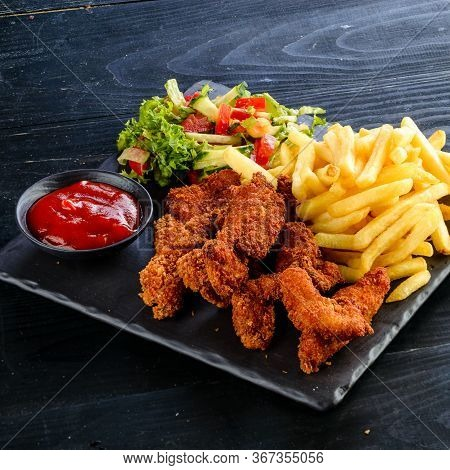 Fried Chicken, Nuggets And French Fries, Set Of Chicken Nuggets, Salad And French Fries On Wood Tabl