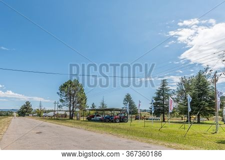 Clocolan, South Africa - March 20, 2020: A Street Scene, With Tractors And Other Agriculture Equipme