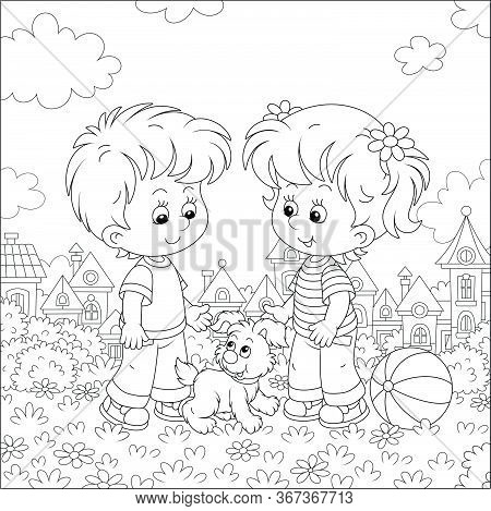 Smiling Little Children Talking And Walking Together With A Cheerful Grey Puppy In A Pretty Town Par