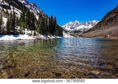 Maroon Bells Lake In Spring Scenic Destination In Colorado