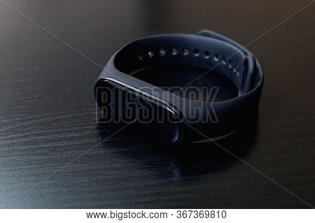 Belarus, Novopolotsk - May 21, 2020: Xiaomi Mi Band 4 On Wooden Table
