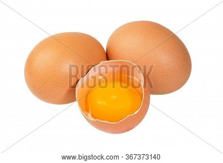Broken Chicken Egg With Yolk Isolated On White Background. Raw Egg.