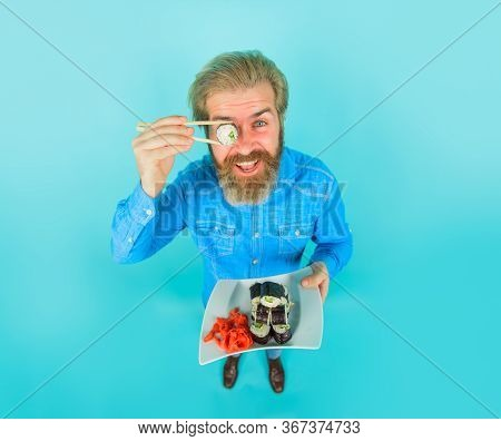 Sushi. Man With Sushi Near Face. Japan. Hipster Eating Sushi. Sushi Delivery. Japanese Food. Pickled
