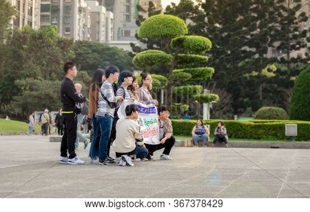 Taipei, Taiwan - January 07: Unnamed Group Of Korean Students Hold Up A Banner In Front Of Chiang Ka