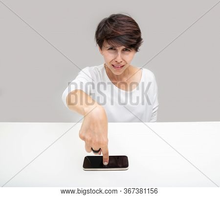 Intense Woman Pointing To Her Mobile Phone