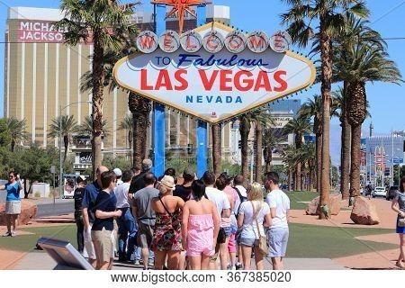 Las Vegas, Usa - April 14, 2014: People Take Photos With Welcome To Fabulous Las Vegas Nevada, Famou
