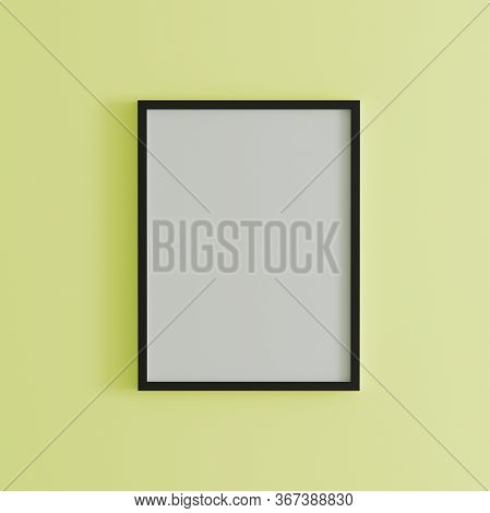 Blank Frame On Light Yellow Wall Mock Up, Vertical Black Poster Frame On Wall,  Picture Frame Isolat