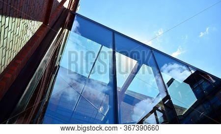 Structural Glass Wall Reflecting Blue Sky. Abstract Modern Architecture Fragment. View Of A Modern G