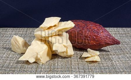 Pieces Of Natural Cocoa Butter With Cocoa Pod. Macro Photo