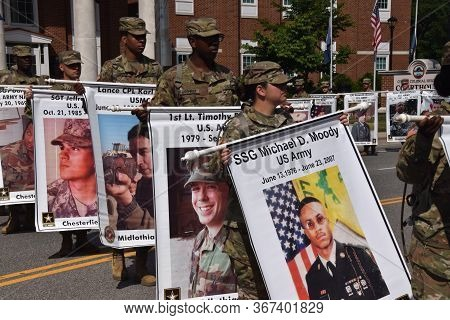 Colonial Heights, Virginia / Usa - May 27, 2019: During A Memorial Day Observance, Soldiers Carry Th