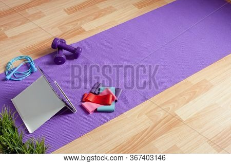 Sports Equipment And A Tablet Computer Are Laid Out On The Floor In A Room. Home Workouts At Home Us