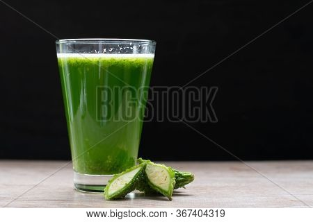 Herbal Juice With Bitter Melon Or Bitter Gourd On Black Background.