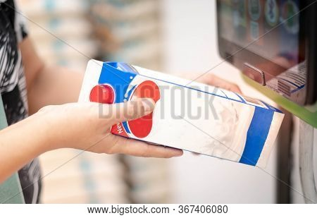 Close-up Of Female Hand Holding Goods  Scanning At Checkout  At The Counter In Supermarket, The New