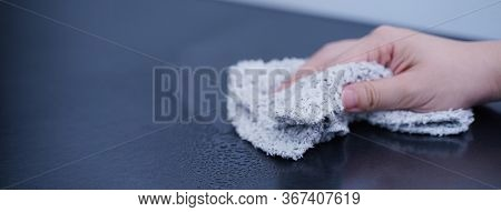 Young Woman Is Holding Spray Bottle, Rag To Clean, Wipe Down Office Metal Cabinet Shelf Accommodatio