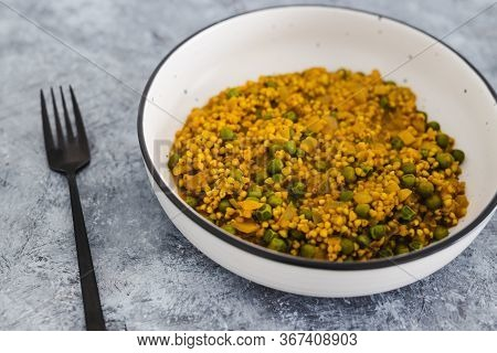 Plant-based Food,  Vegan Onion Turmeric Buckwheat With Green Peas