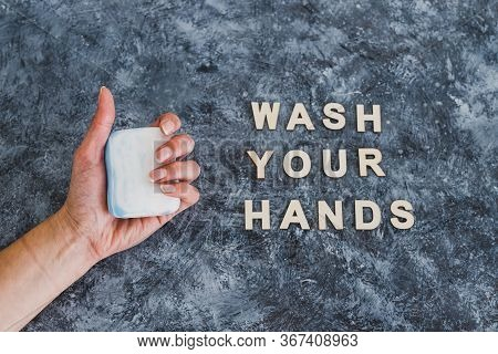 Fight Bacteria And Viruses, Hand Holding Soap Next To Wash Your Hands Text.