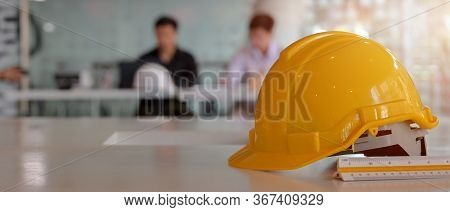 Close Up View Of Engineer Worktable With Safety Helmet, Copy Space And Measuring Tool