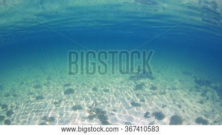 Sea sand and blue water underwater photo