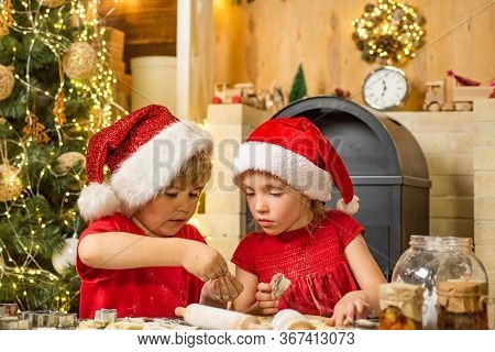 Cute Kids In Santa Hats Preparation Holiday Dinner For Family. Santa Cook. Cookie On Christmas Eve A