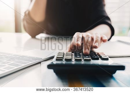 Close Up Business Woman Using Calculator And Laptop For Do Math Finance