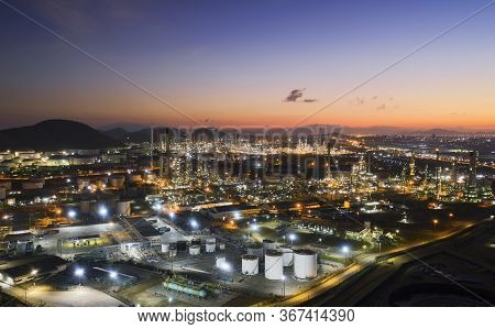 Aerial View Oil Storage Tank With Oil Refinery Factory Industrial. Oil Refinery Plant At Night. Indu