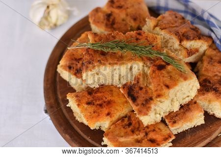 Homemade Italian Focaccia Modenese, With Rosemary And Olive Oil/ Freshly Baked Flat Bread Whit Herbs