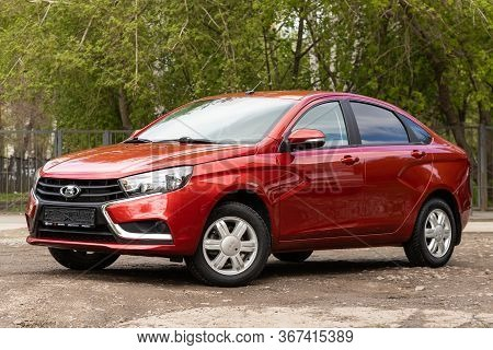 Novosibirsk/ Russia - May 03 2020: Red Lada Vesta,  Front View.  Modern  Sedan Made In Russia On A P