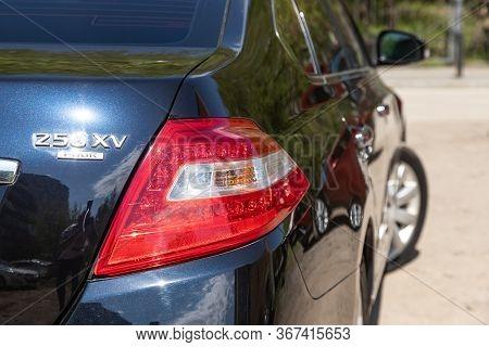 Novosibirsk/ Russia - May 03 2020: Nissan Teana, Black Car Headlights. Exterior Detail. Close Up Det