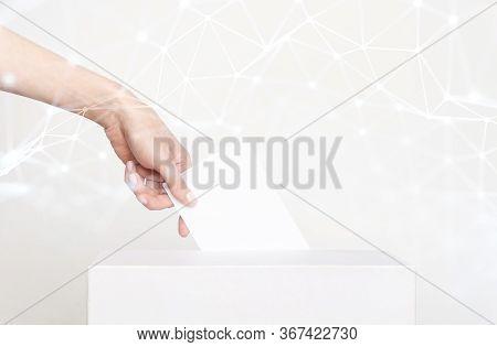 Voter Holding Ballot For Remote Voting. Modern Technology Lockdown Concept