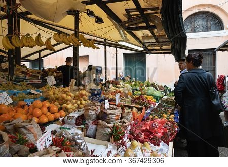 Venice,italy - October 18,2019: An Unidentified People Buying Fresh Fruits And Vegetables At Rialto