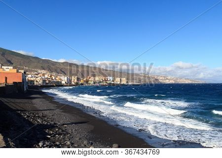 Coastline, Black Sand Pebble Beach And Town Candelaria Panorama With Atlantic Ocean On Canary Island