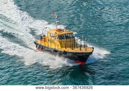 Miami, Fl, United States - April 28, 2019: Miami Based Pilot Boat Guiding A Ship Out To Sea And Used