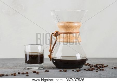 A Device For Brewing Coffee Using A Filter. Close Up On The Table.