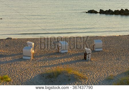 Beach Chair On The Baltic Sea Coast. In Travemuende, Germany