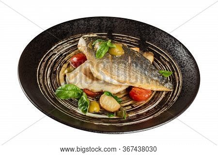 Grilled Fish Fillet With Side Dish. Served In A Black Plate Isolated On A White Background.