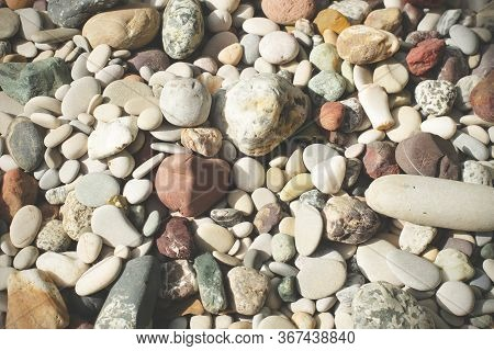 Colorful Pebbles Background. Stones On The Beach. Pebbles Texture.