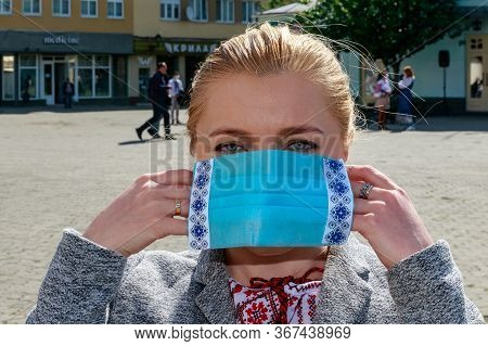 Uzhgorod, Ukraine - May 21, 2020. A Girl In A Ukrainian Embroidered Shirt Wears A Protective Mask Wi