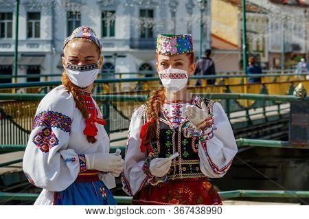 Uzhgorod, Ukraine - May 21, 2020: Girls In Ukrainian National Costumes And Embroidered Protective Ma