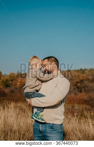 Fathers Day, Happy Loving Family. Father And Son Playing, Having Fun On The Nature. Happy Family, Fa