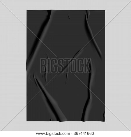 Black Glued Paper With Wet Wrinkled Effect On Gray Background. Black Wet Paper Poster Template With
