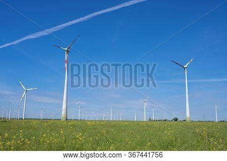 Modern Wind Wheels With A Clear Blue Sky Seen In Germany